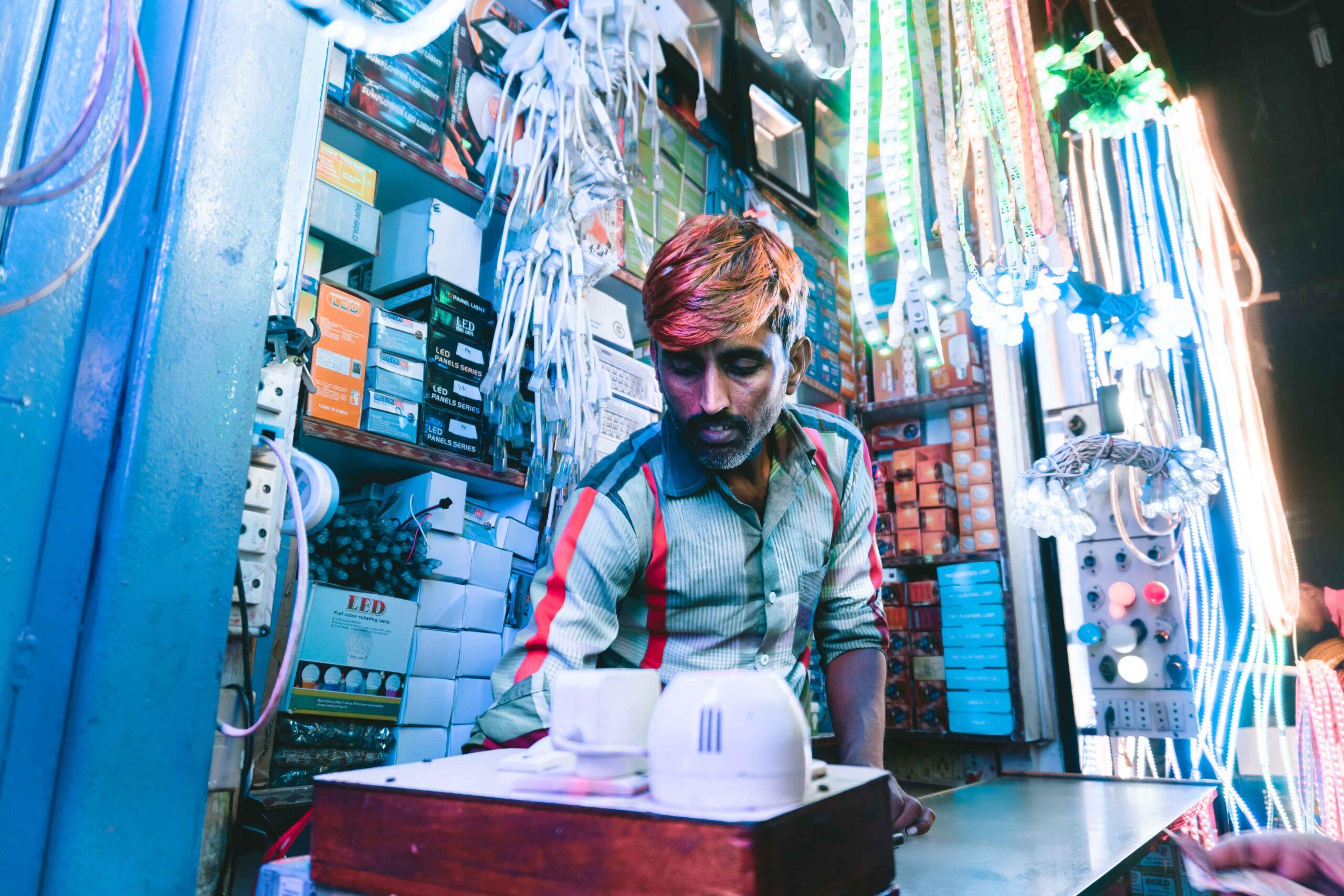 Man running a small electronics shop